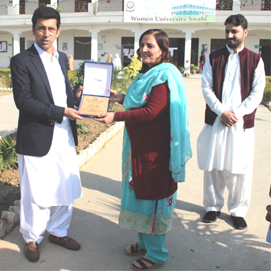 Worthy Vice Chancellor Women University Swabi Presenting Shield to Honorable Minister of Health & IT, KP, Shahram Khan Tarakai